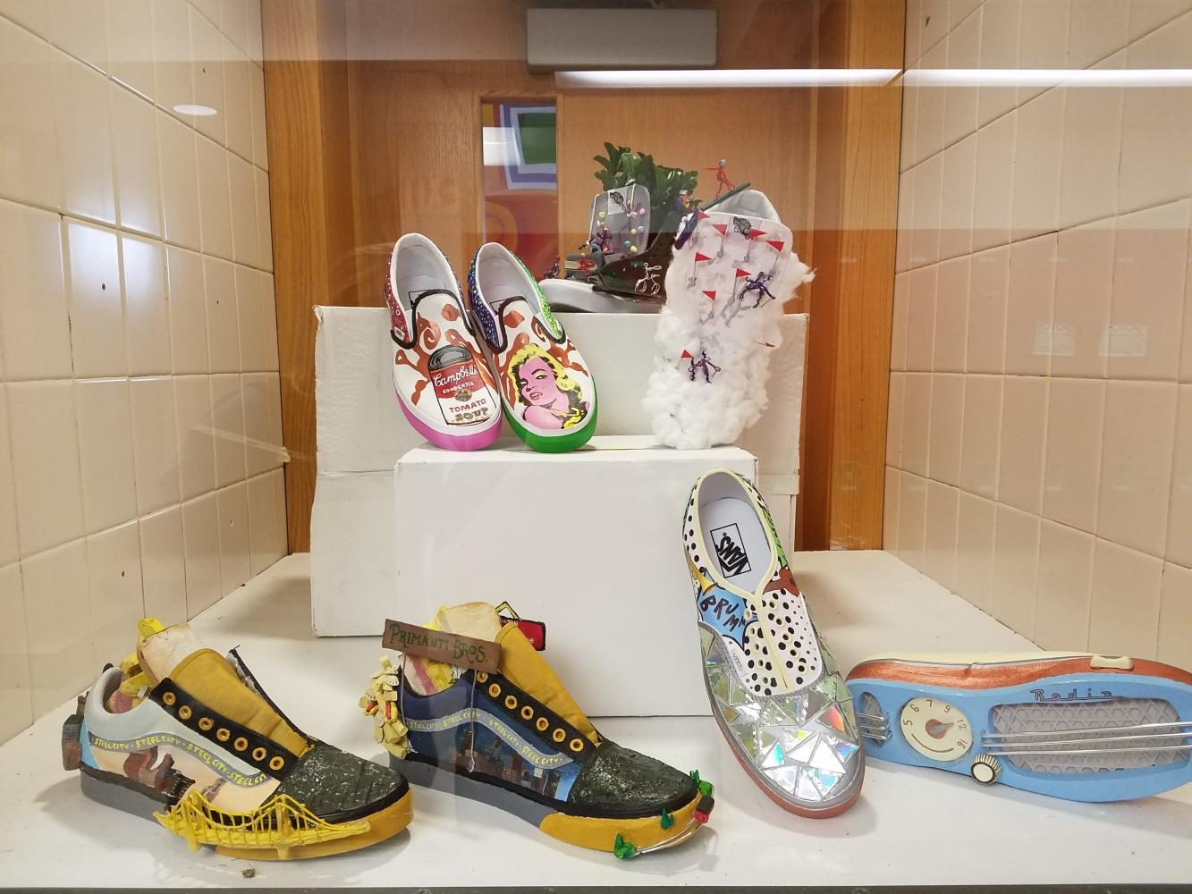 The+shoes+the+participating+FHS+students+designed+are+on+display+outside+of+the+art+classroom.%0A