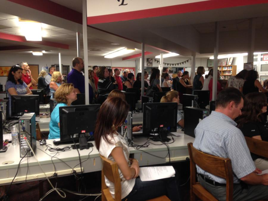 FASD teachers and community members fill the middle school library for the June 18 school board meeting.