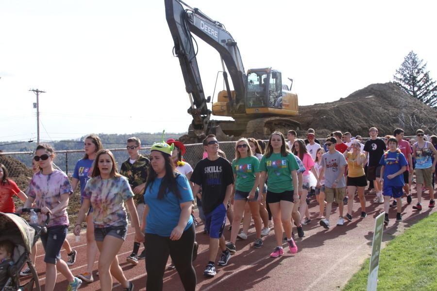 Cancer survivors walk the survivors lap during the Relay on May 2.