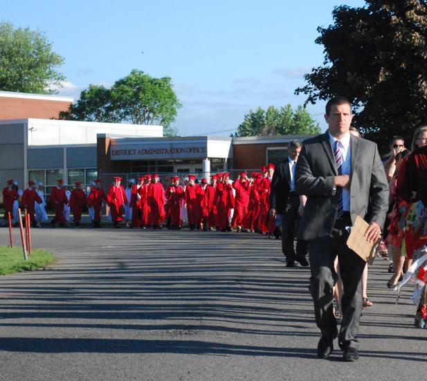 Hernandez leads the class of 2014 to Bulldog Stadium for commencement in June 2014.