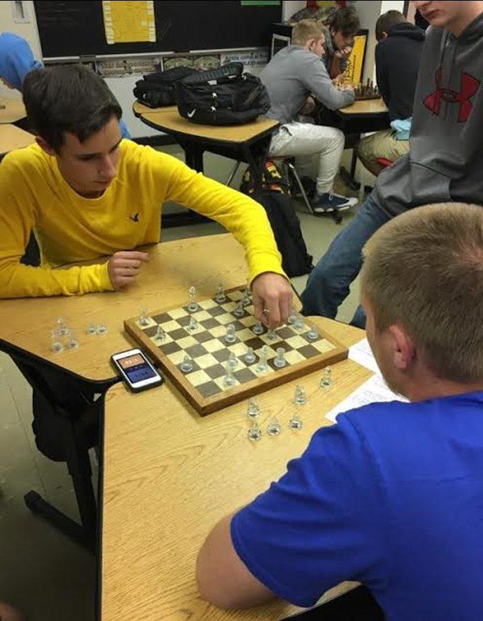 Chess club senior members Jarrett Boyd and Jordan Herzog play a one-on-one game.