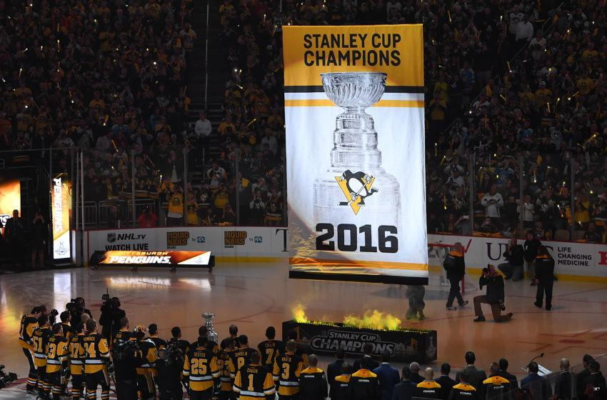 Penguins players and fans watch as the 2016 Championship banner is raised to the rafters