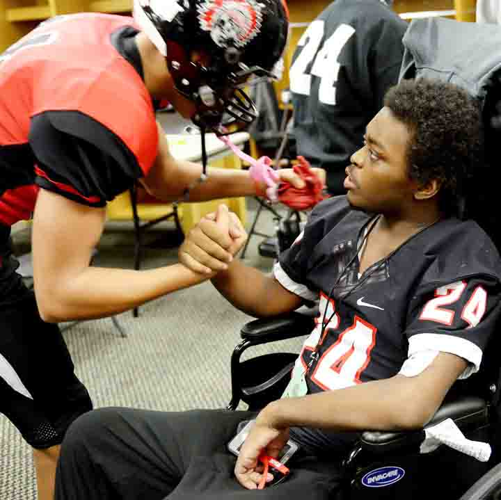Former Aliquippa student and football player DiMantae Bronaugh shakes hands with a teammate before the WPIAL championship game on Nov. 18.
