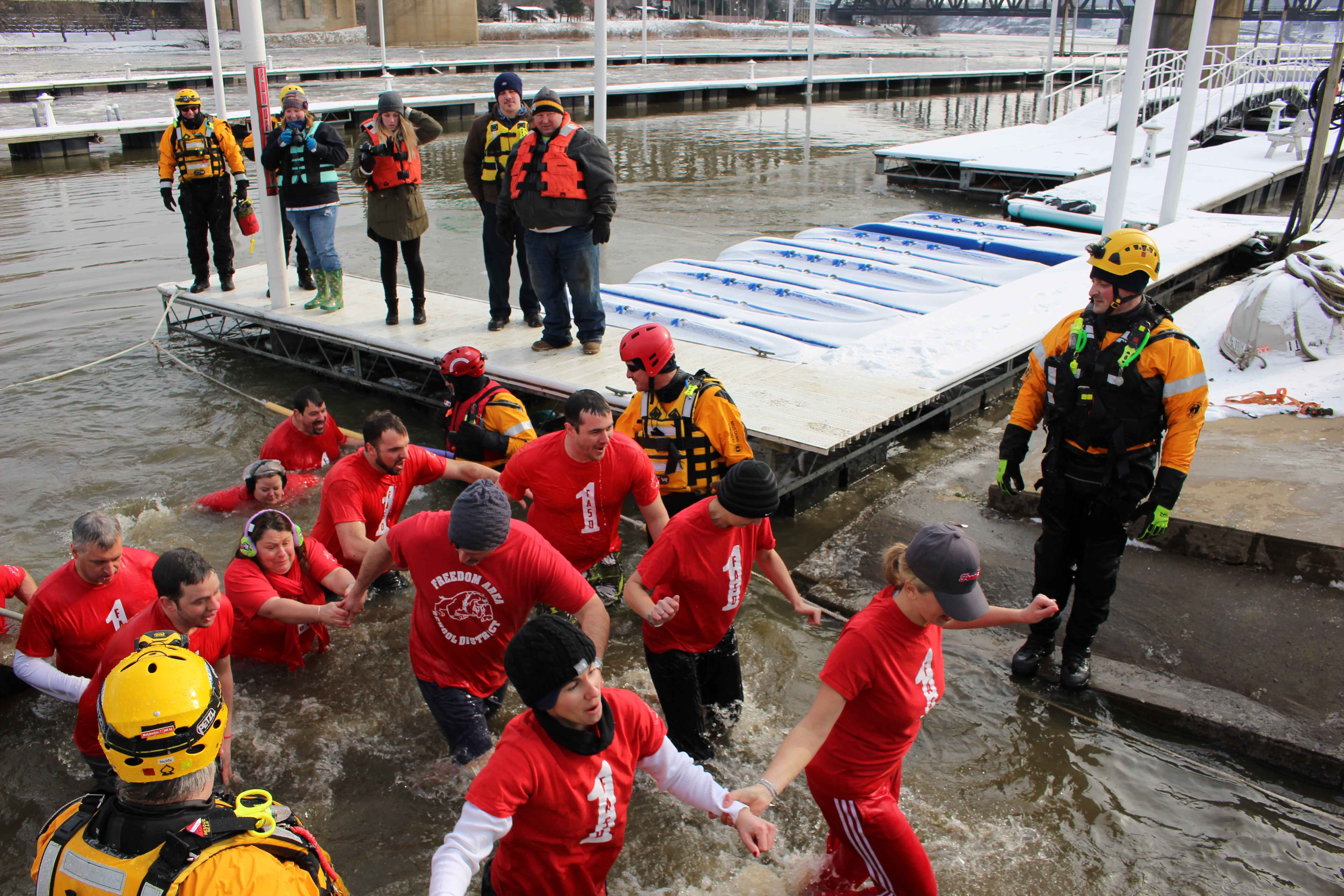 The Slush Puppies bear the cold waters of the Ohio River on Jan. 7 for the annual Special Olympics fundraiser.
