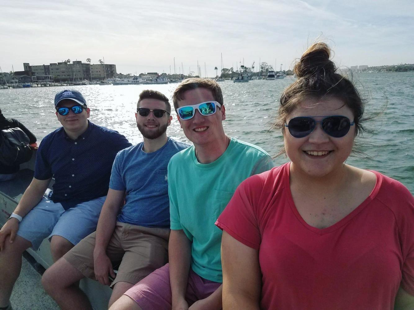 DECA members junior Daniel White, senior Avery Sayre, senior Devin Daley and junior Rachel DeCesaris ride the ferry in sunny Newport Beach, California.