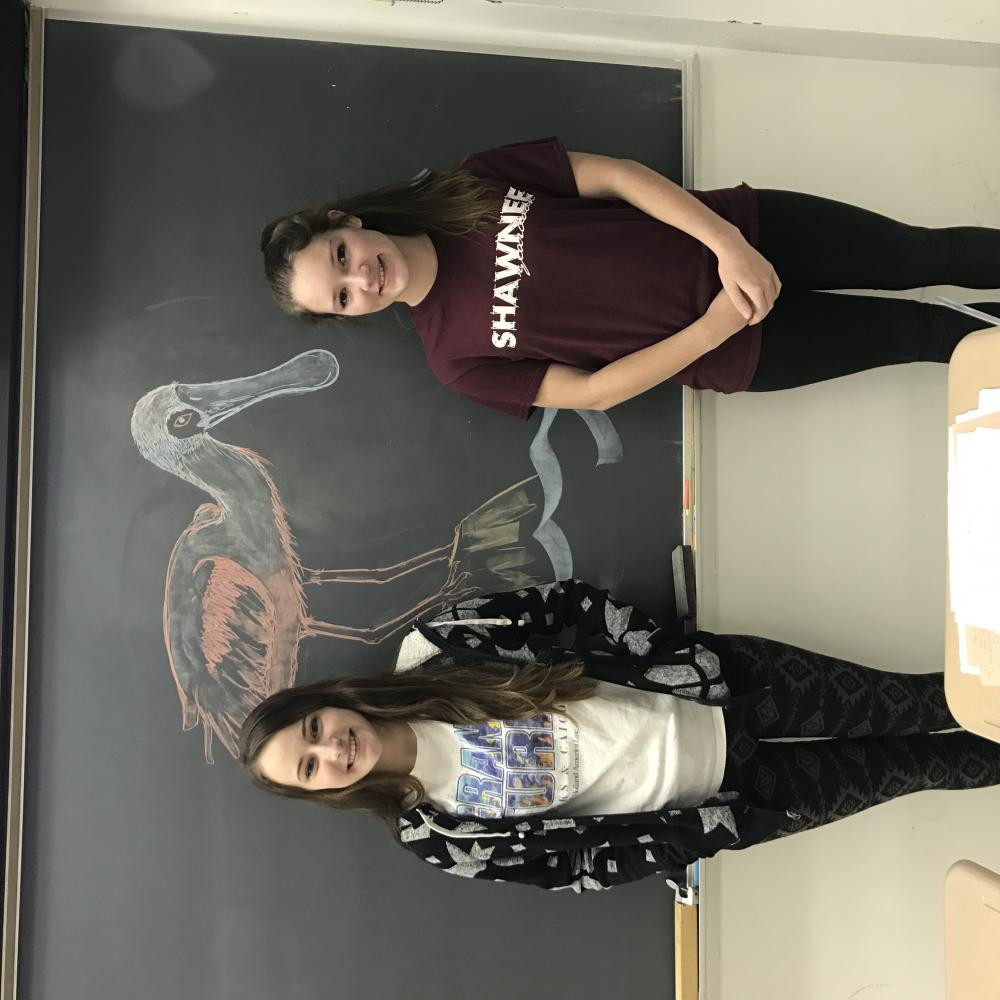 Seniors Breanna Leasure and Brianna McKee, two attendees of the Raptorthon, pose for a photo.