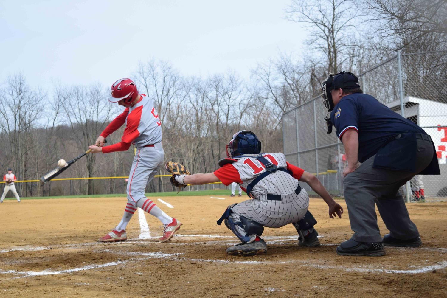 Sophomore Zach Rosa makes contact with the ball during the home game versus Summit Academy on April 5.