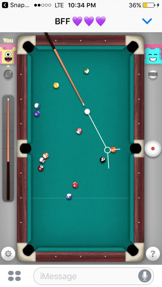 A game of 8-ball is played between two friends in the new iMessage feature.
