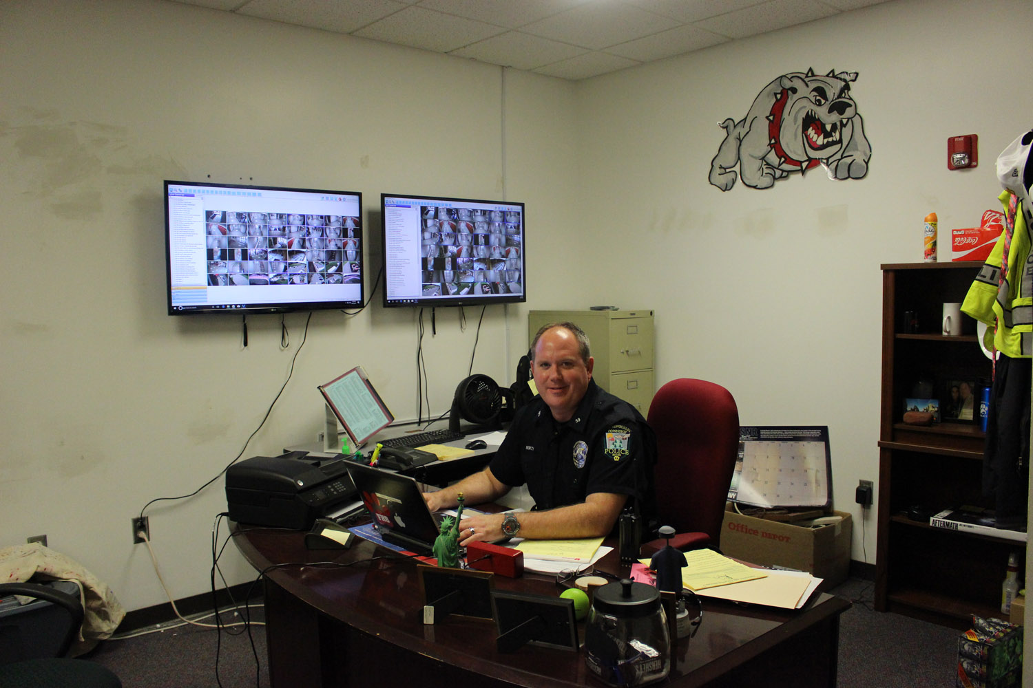 Resource Officer Tom Liberty sits at his desk in his new office space.