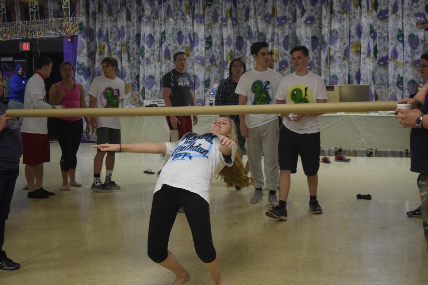 Ally Schmiedlin, along with other seniors, enjoy a game of limbo at Project Graduation.
