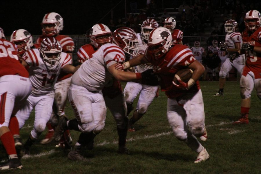 Junior Cody Ross attempts to gain rushing yards against the Mohawk Warriors.
