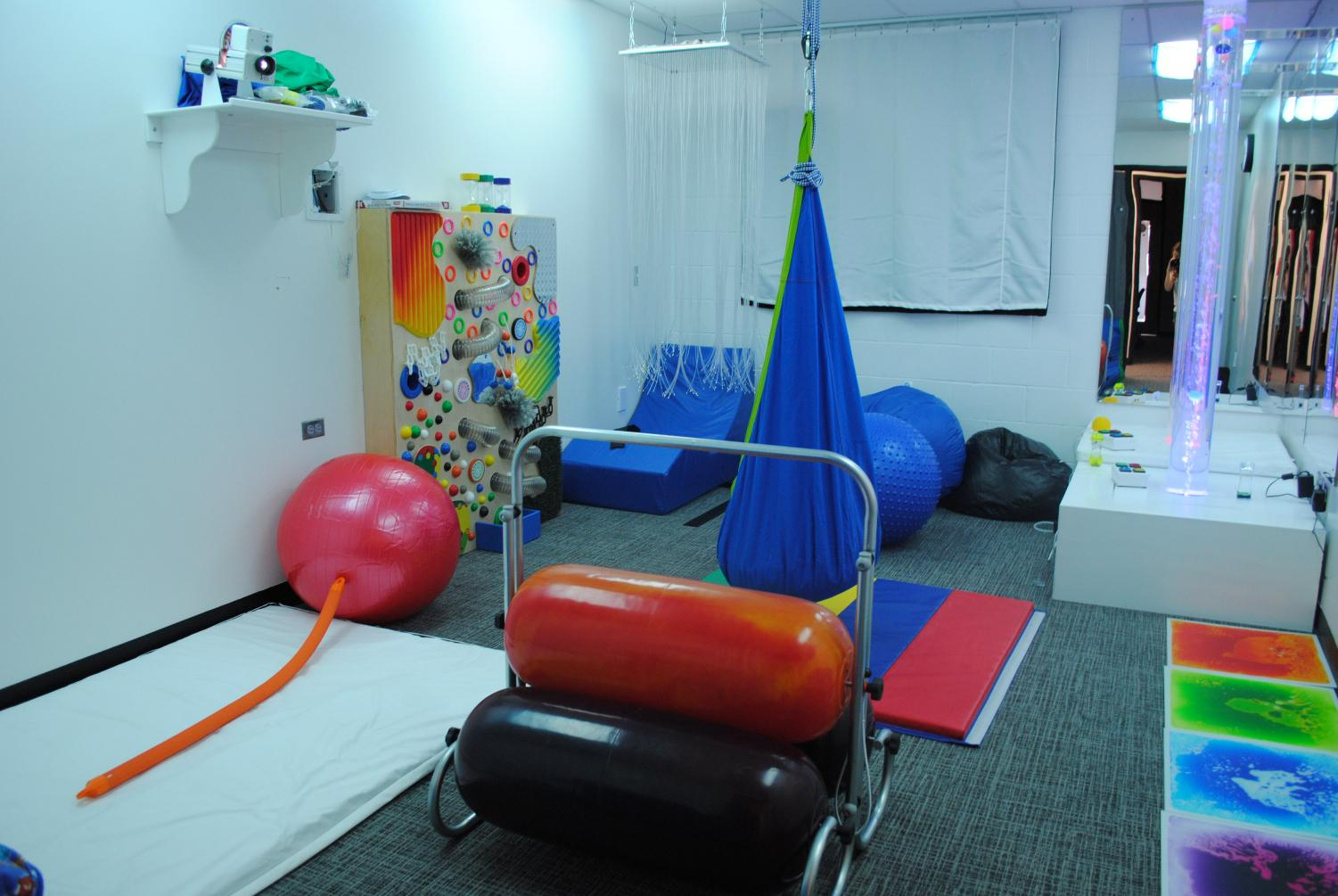 The sensory room is filled with a lot of equipment to help students.
