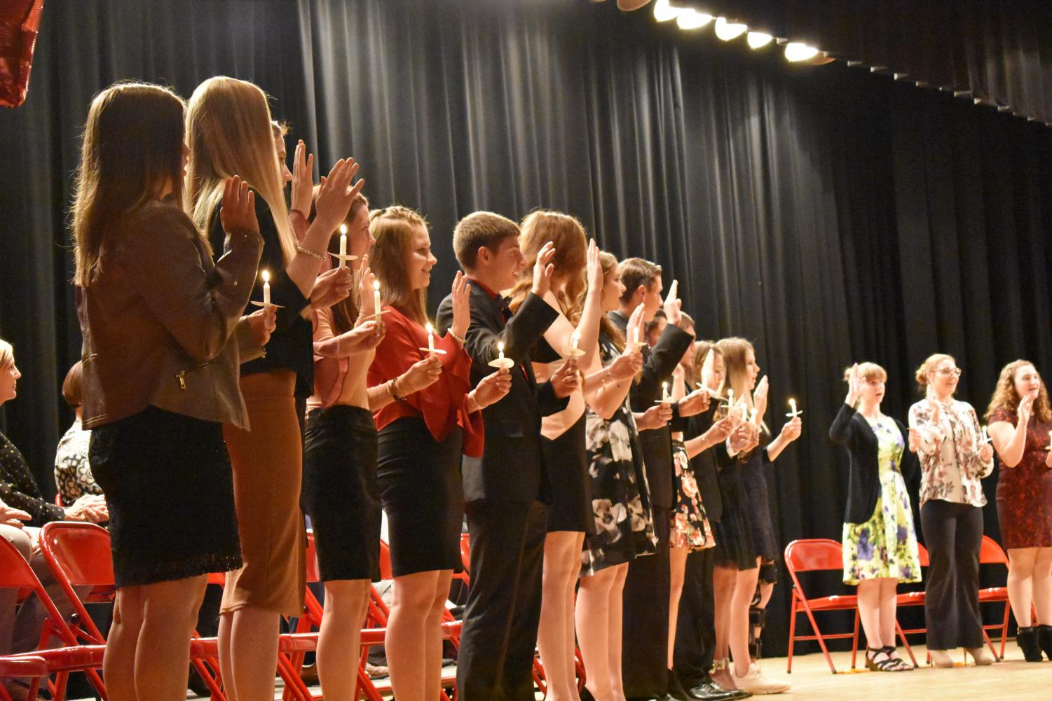 The new members, Jordyn Wright, Melissa Keith, Robin Kaufman, Claudia Huggins, Taylor Greene, Carson Gilarno, Marydeth Feits, Jenna Engel, David Eisenbrown, Kassandra DePoppe, Joshua Beck, Alexsia Barlamas and Myla Sharpless take the oath to be entered into NHS.