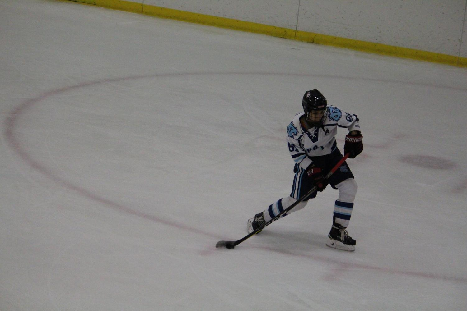 Senior Jimmy Kelly-Tindall winds up a shot to make it 2-0 in the first period against Elizabeth Forward.