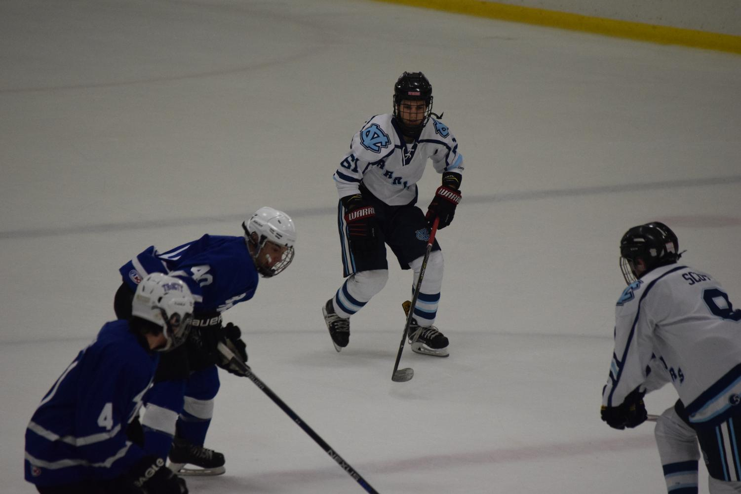 Senior James Kelly-Tindall fights towards the puck at the game on Dec. 14 against Connellsville.
