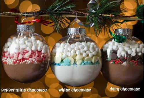 Three hot chocolate mix combinations hanging on a Christmas tree to display some possible combinations.