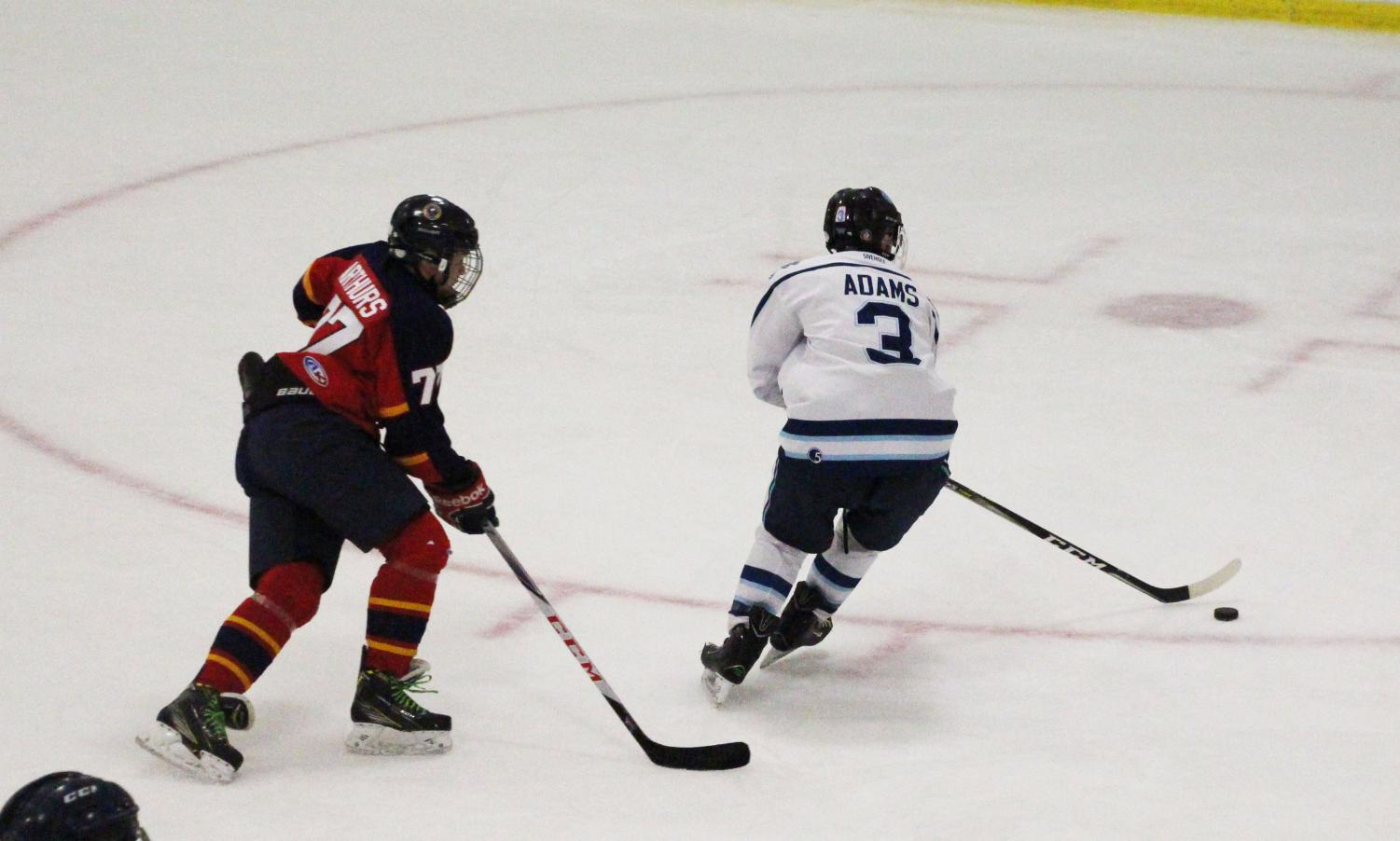 Junior Riley Adams winds up a backhand shot on goal.