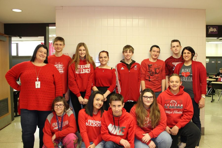 +Ms.+Andrea+Niedbala%2C+Ms.+Maria+Porter+and+ninth+grade+students+wore+red+to+show+their+support+on+Feb.+2.