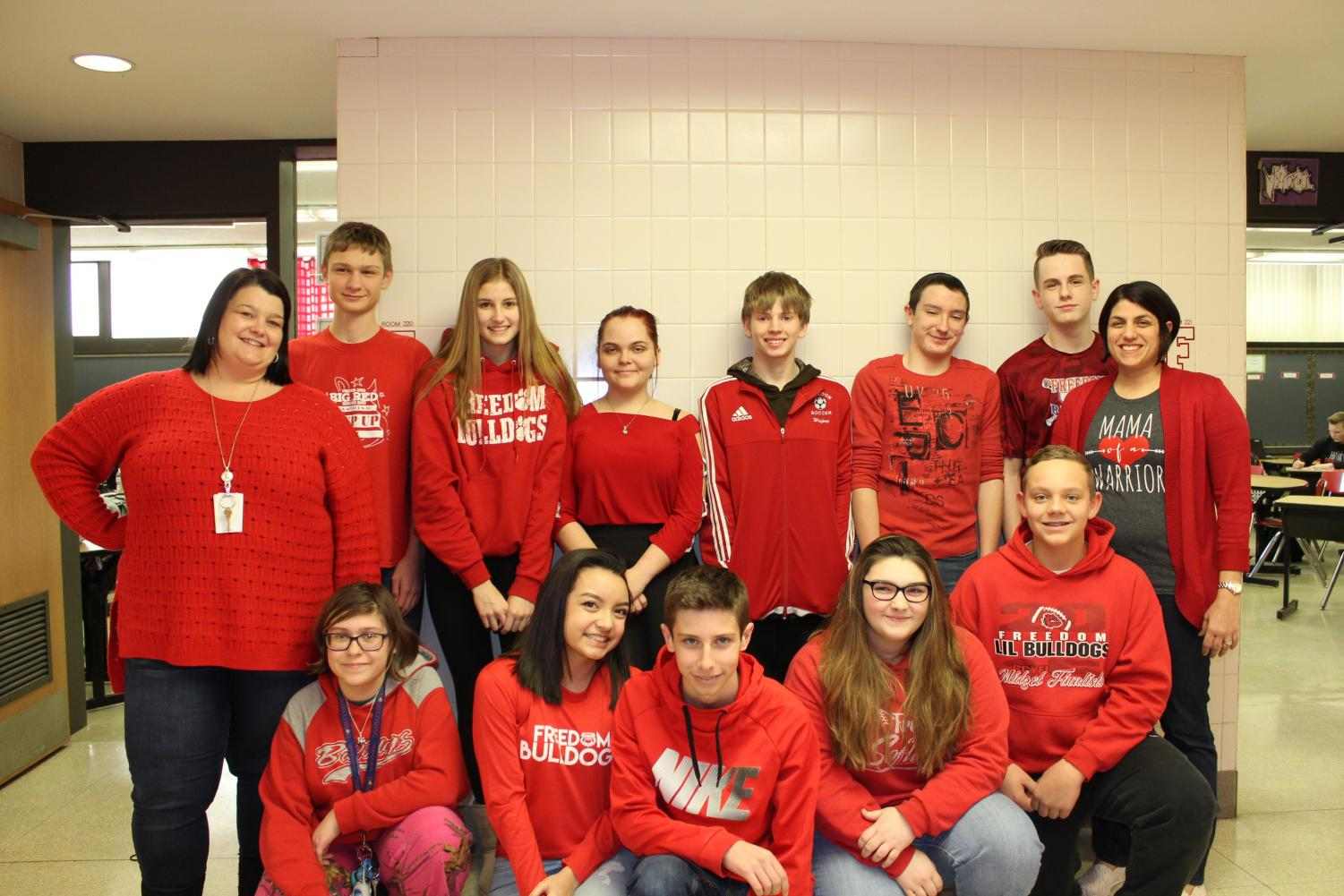 Ms. Andrea Niedbala, Ms. Maria Porter and ninth grade students wore red to show their support on Feb. 2.