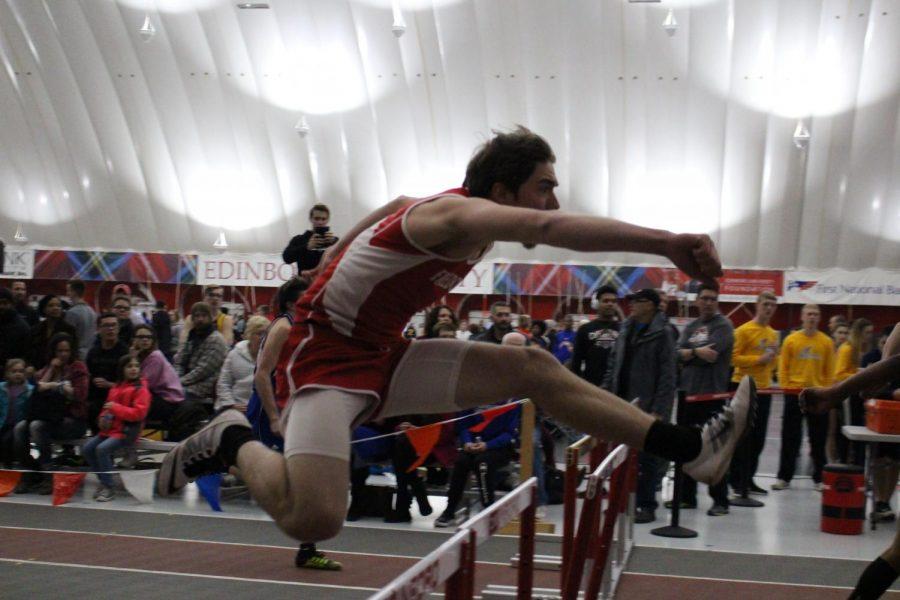 Senior Michael Keith puts a good foot forward into his hurdle at a meet.