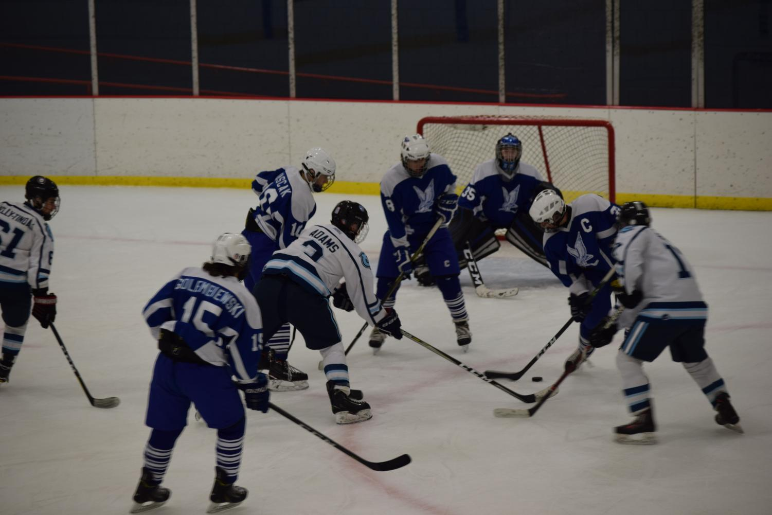 Junior Riley Adams faces three players from Connellsville on Dec. 14 as he makes his way towards the goal with the puck.