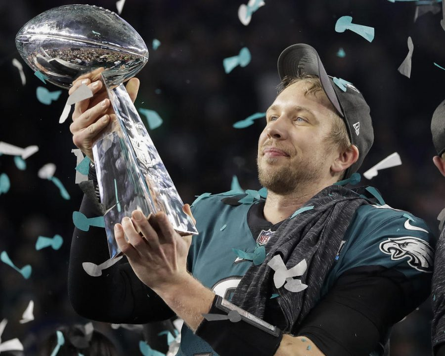 Super+bowl+MVP+Nick+Foles+holds+the+Lombardi+Trophy+high+after+winning+it+for+the+first+time.