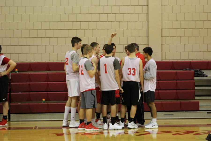The+Boys+Basketball+team+huddles+up+during+game+against+Western+Beaver.