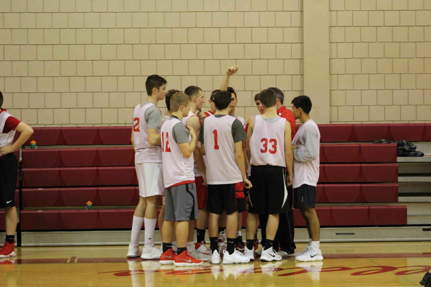 The Boys Basketball team huddles up during game against Western Beaver.