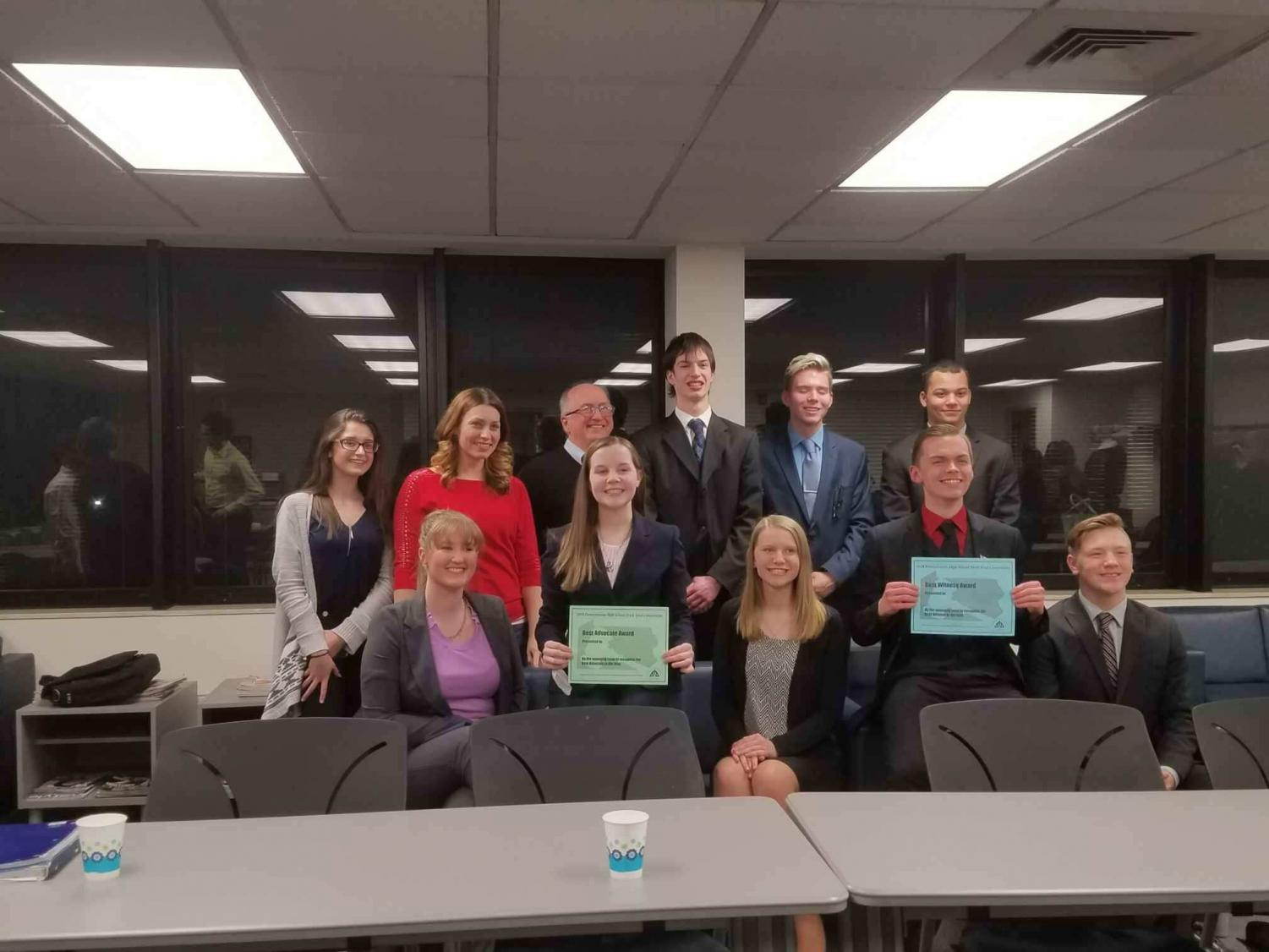 The New Brighton mock trial team stands together for a photo after the regional competition.