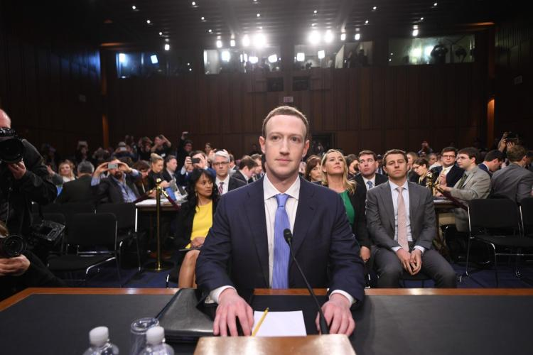 CEO of Facebook, Mark Zuckerberg (center), sits in front of 44 Senators on April 10, 2018, to give a testimony about the data scandal that affected millions of the social media platform's users.