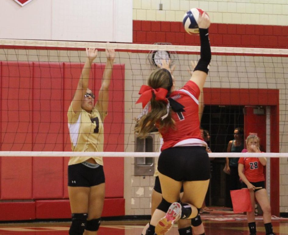 Senior Jenna Engel attacks the ball in an attempt to get a point against Chartiers-Houston on Sept. 4.