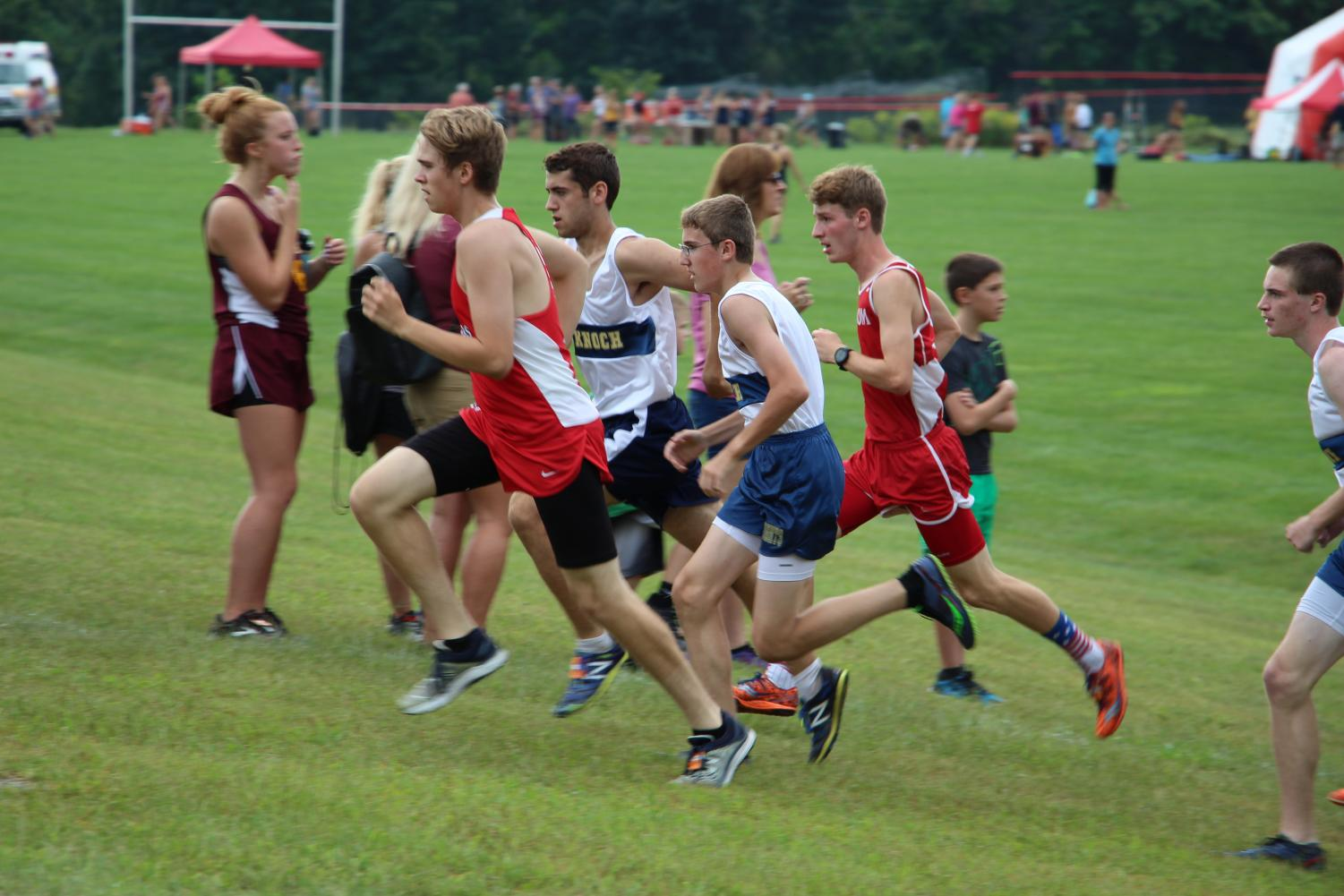 Junior Adam Hessler gains on competitors from opposing schools as he approaches the finish line.