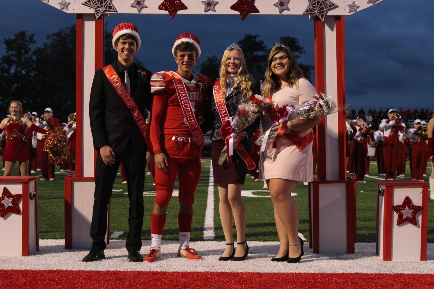 Rachel DeCesaris and Micheal Keith crown the next Homecoming King (Riley Adams) and Queen (Melissa Keith).