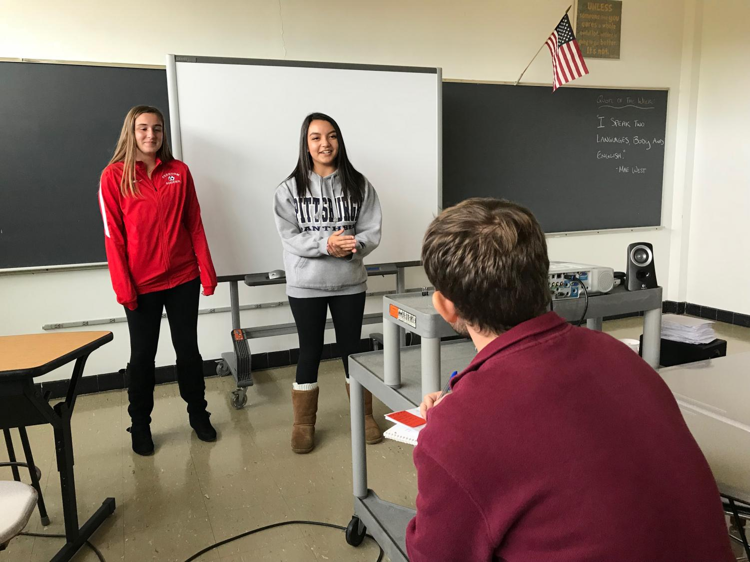 Sophomores Jessica Scheel and Madison Lewis practice a roleplay for Adviser Bradley Baldwin to start practicing for the actual competition in December.
