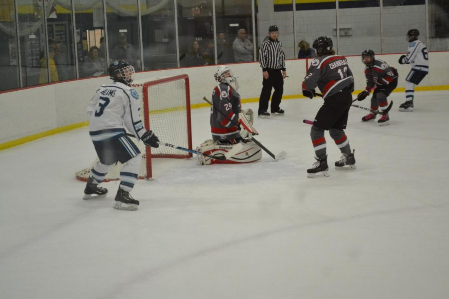 Senior+Riley+Adams+%28left%29+is+shown+waiting+by+the+net+for+the+puck+in+the+hopes+of+scoring+at+the+game+on+Oct.+18