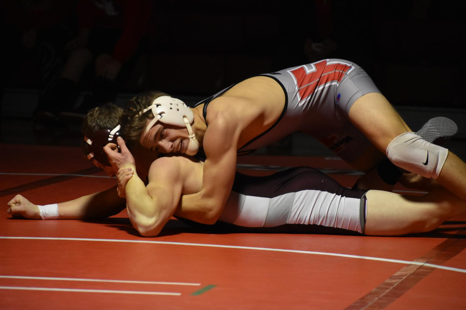 Senior Jake Pail attempts to pin his opponent during a match against Beaver on Dec. 20, 2017.