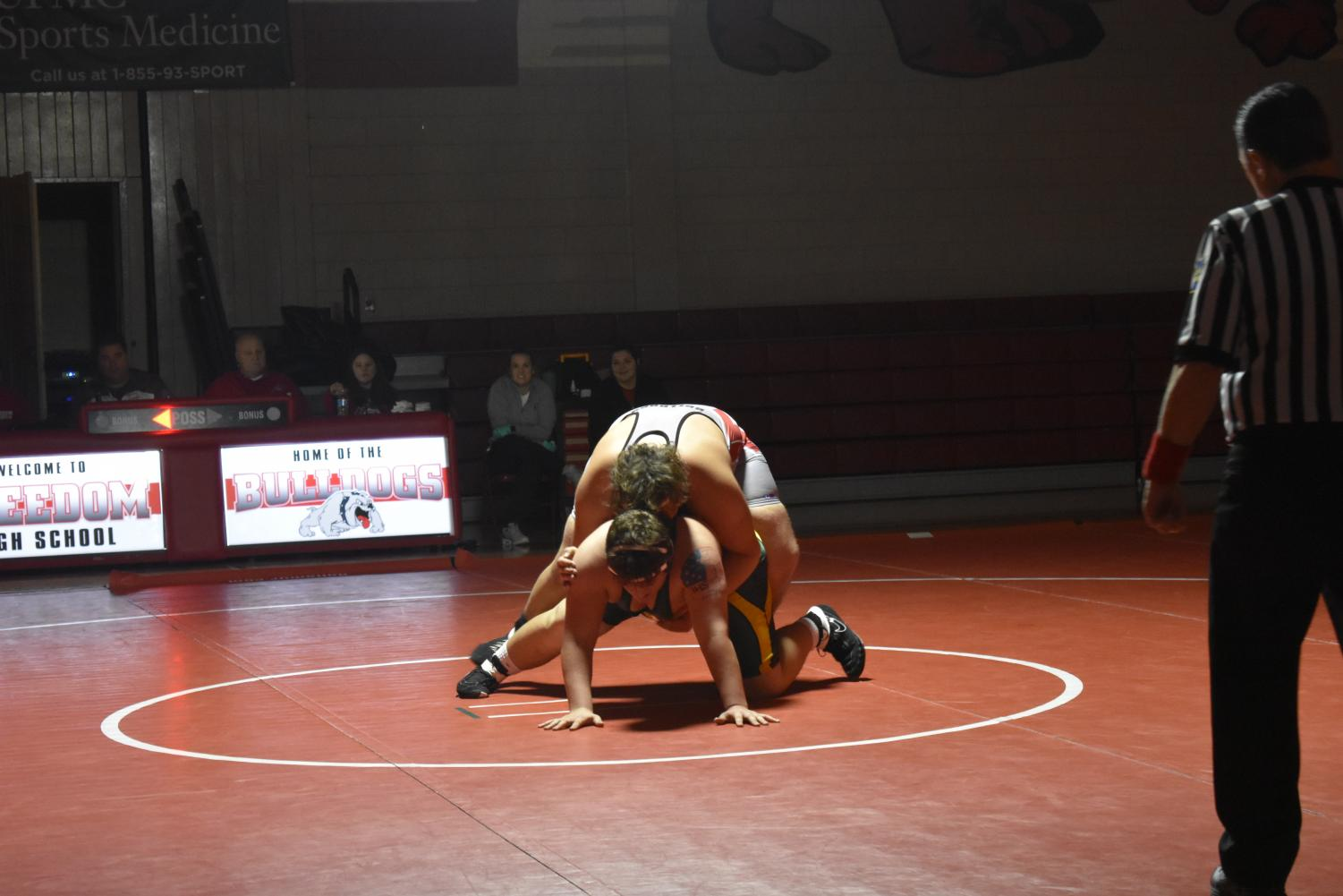 During the home match against Blackhawk High School on Dec. 12, Nando Franco attempts to hold down his opponent to contribute more points to Freedom's score.
