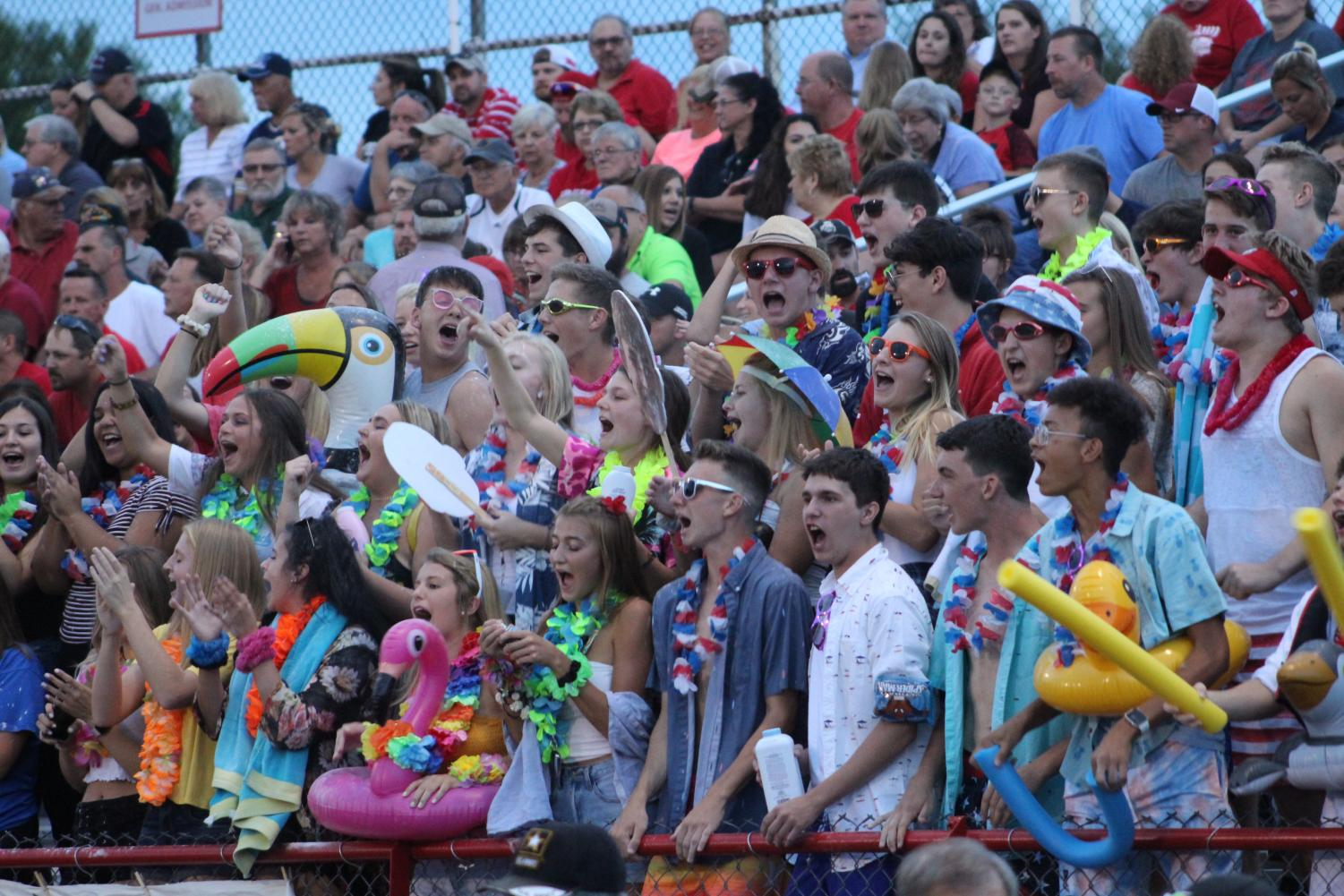 Students cheer on the football team as they prepare to stop Riverside on a crucial third down.