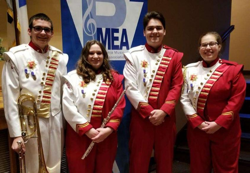 Juniors Cole Skuse and Mason Hedge, sophomore Marissa Lammie and senior Mikayla Evans pose for photo prior to their concert at Honors Band on Dec. 1.
