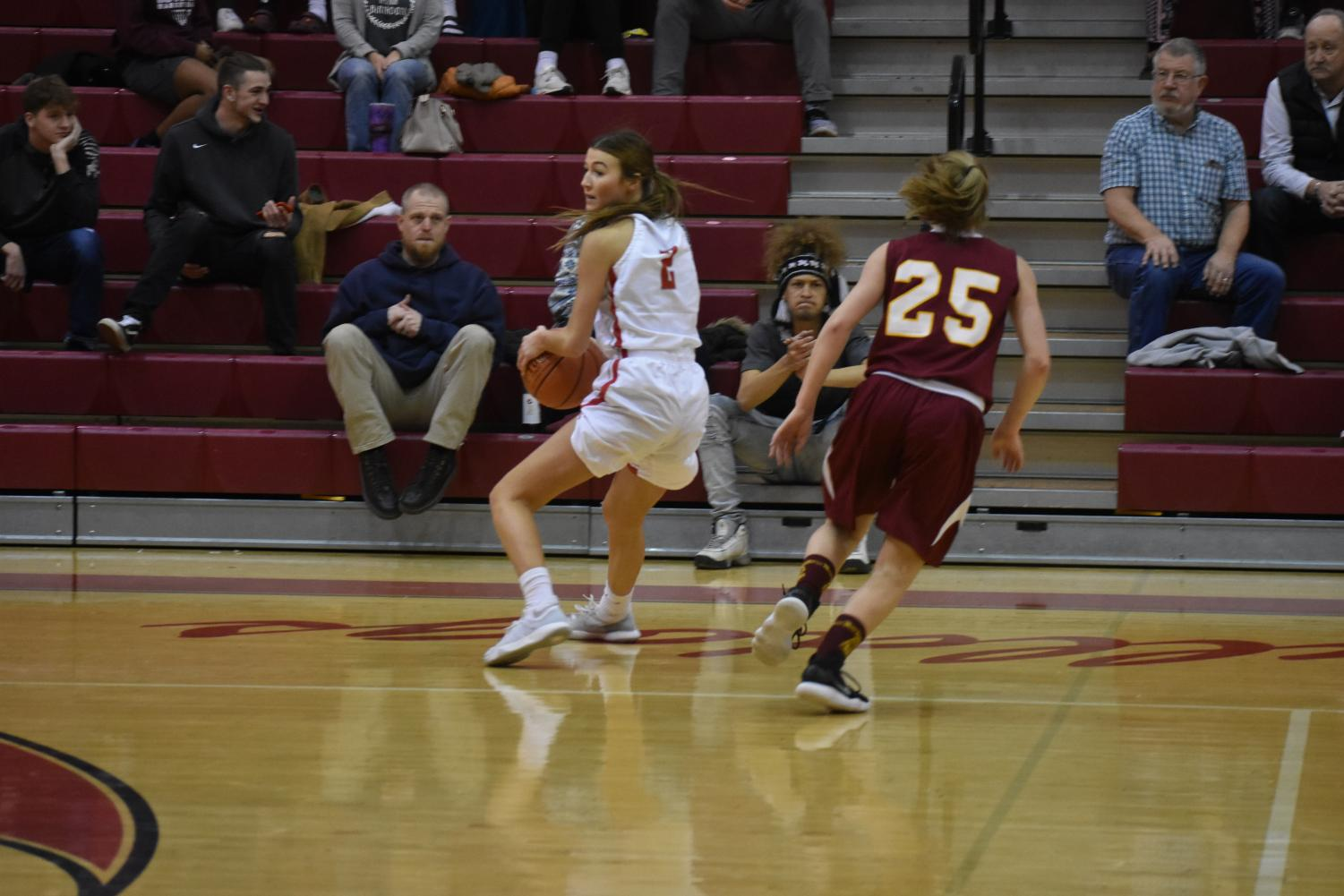 Senior Chloe Keller searches for a teammate to pass the ball to.