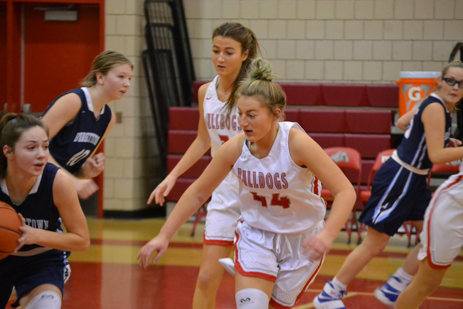 Senior Chloe Keller and sophomore Karissa Mercier watch the ball for an opportunity to steal on a game against Burgettstown on Jan. 11.