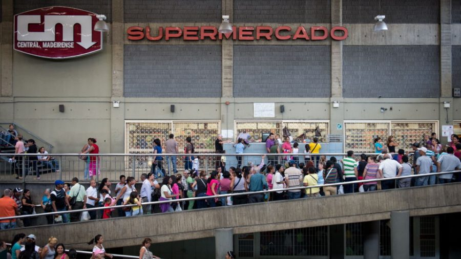 Many+Venezuelans+have+to+resort+to+standing+in+lines+that+are+up+to+multiple+blocks+long+to+buy+necessities+like+milk%2C+bread%2C+detergent+and+toilet+paper.