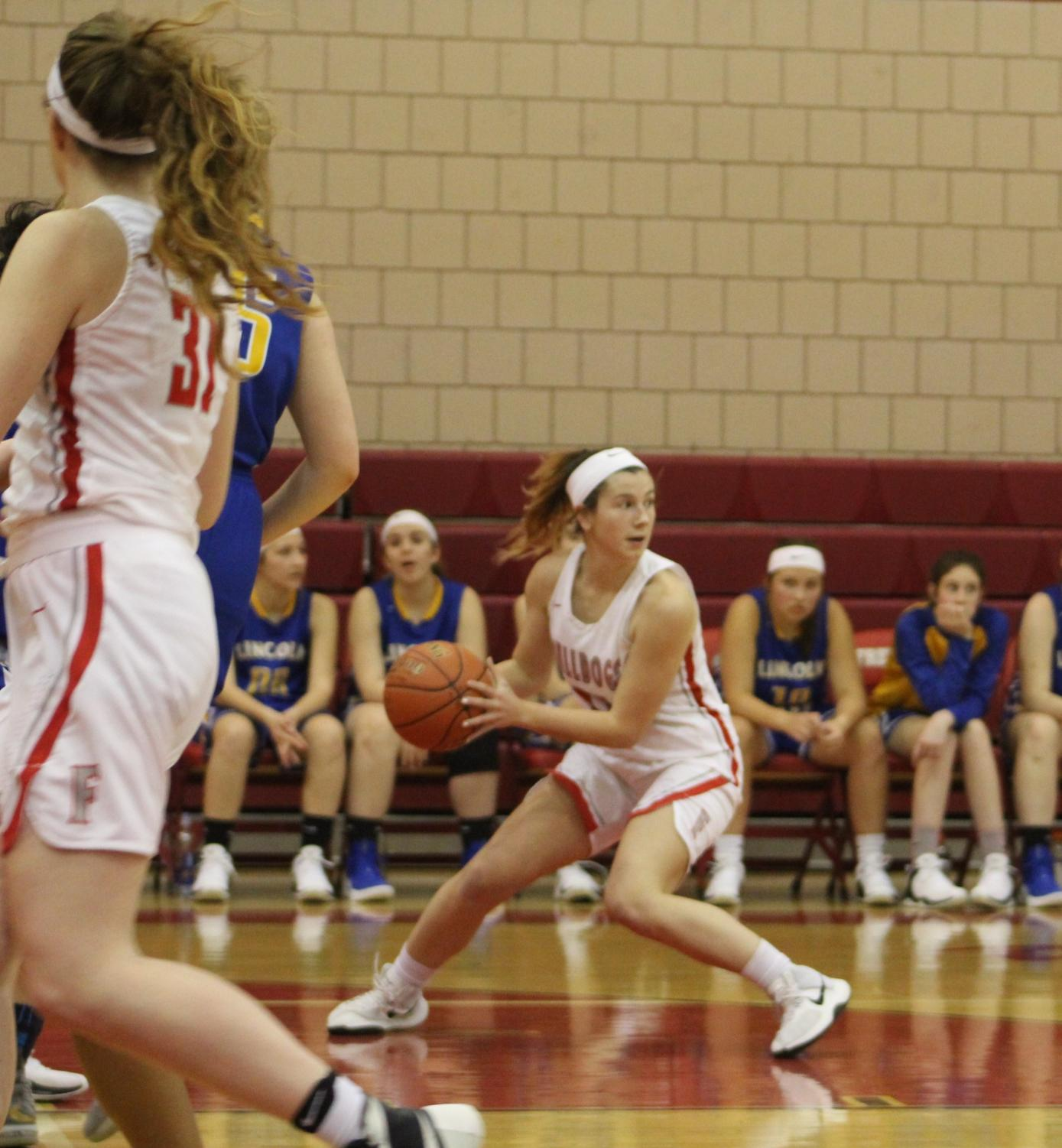 Freshman player Renae Mohrbacher searches for a teammate to pass to during the second quarter of the Lady Bulldogs final game of the season on Feb. 11.