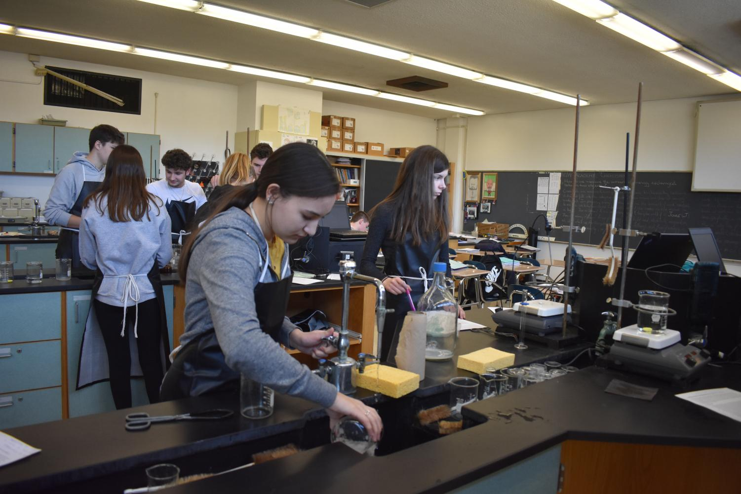 Sophomore Lauren Lizzi and freshman Erin Harp work to complete their lab in chemistry, utilizing the eighty minute block. A schedule change to forty minutes would make a lab like this difficult to complete.
