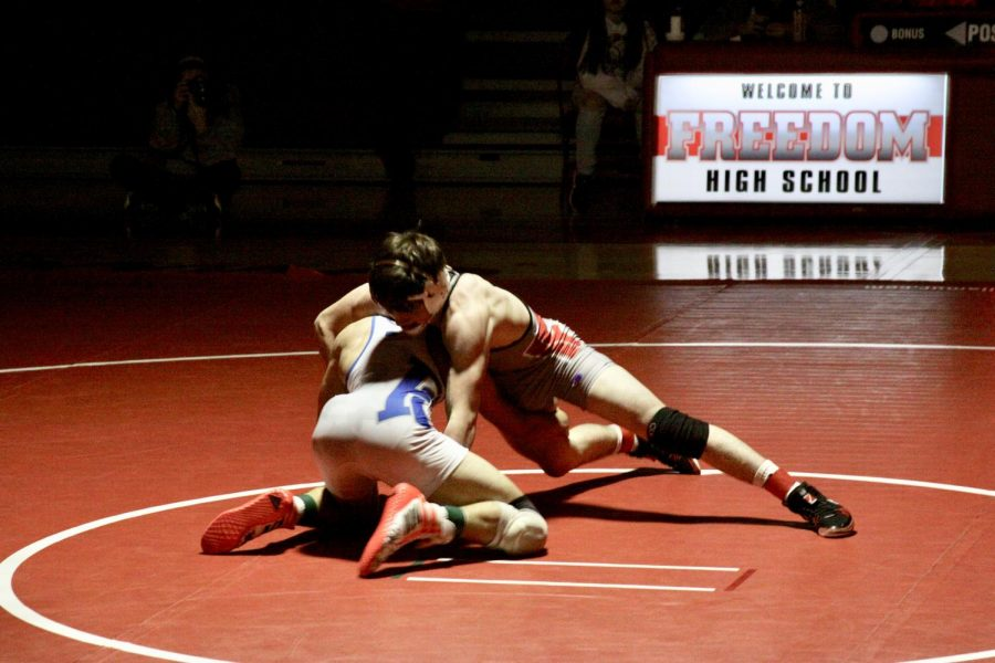Wrestlers+continue+to+perform+at+matches+throughout+the+season+even+though+weight+cuts+and+training.+