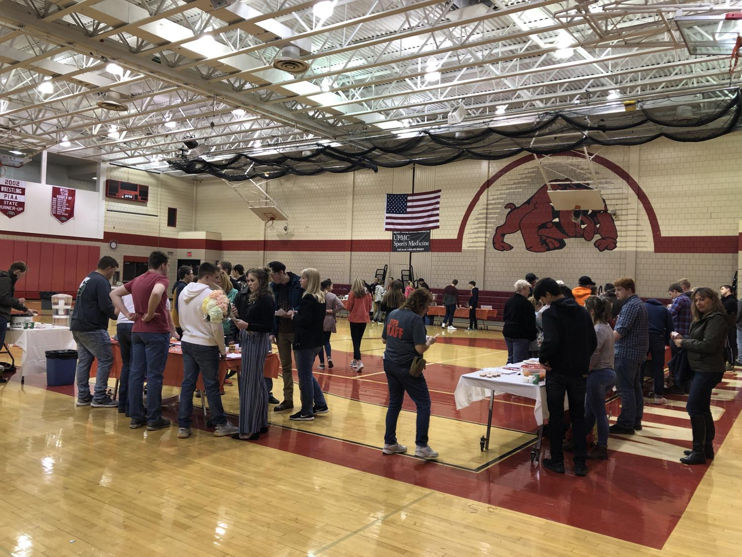 Tables were set up in the high school gymnasium for all of the students' foods to be put out on. Participants and community members were able to go around the tables and try out all of the healthy foods.