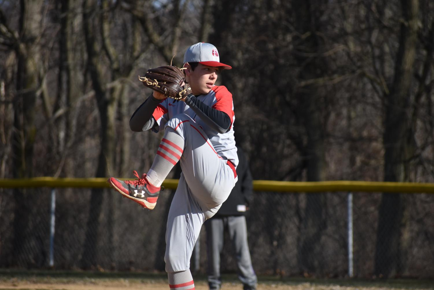 Junior Jacob Bauman is one of many returning players from last year. Above as a sophomore, Bauman is seen gearing up for a pitch during the Bulldogs game against Summit Academy on March 13.