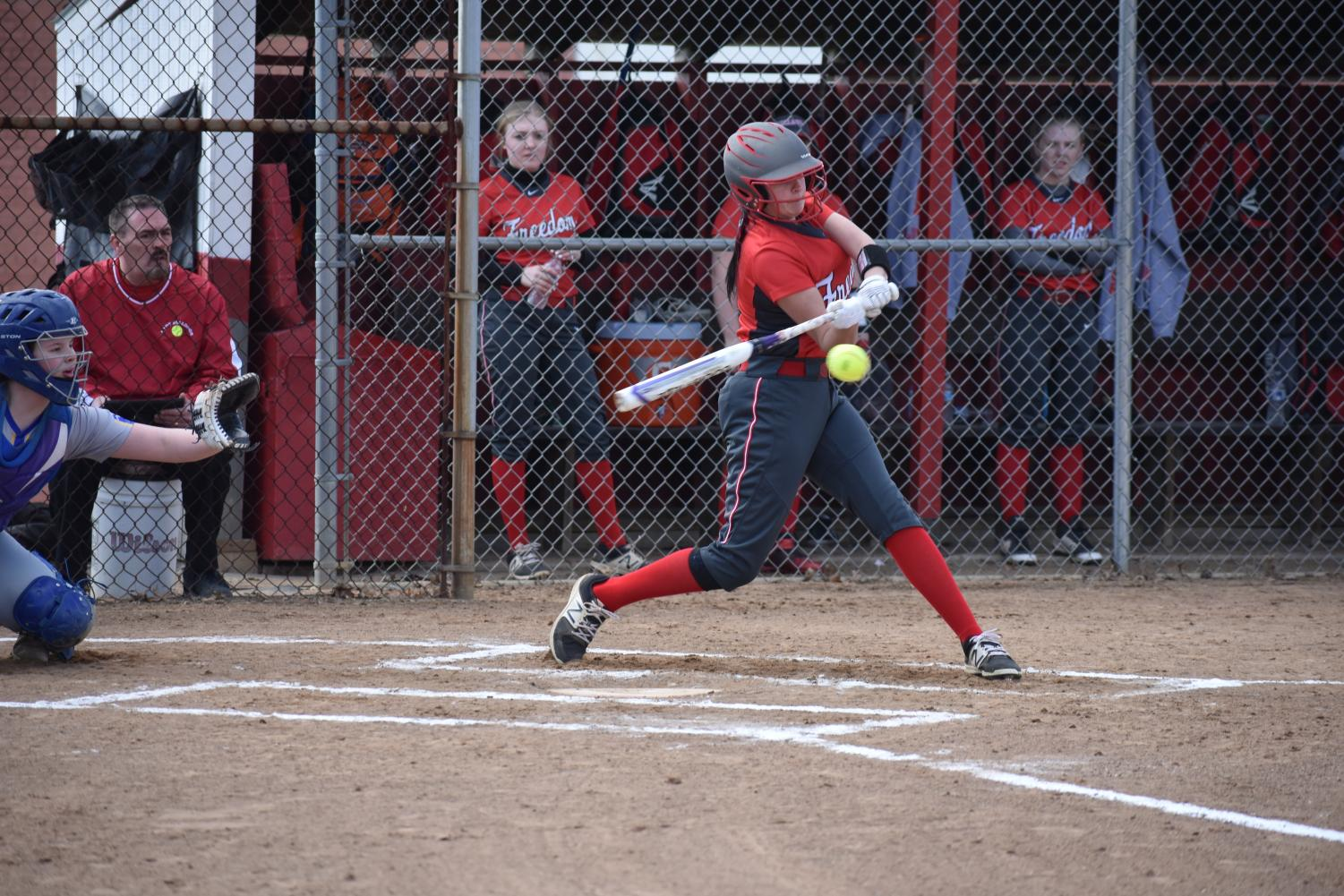 Sophomore Olivia Shaffer singles during the Bulldogs' home game on March 19 against Avella.