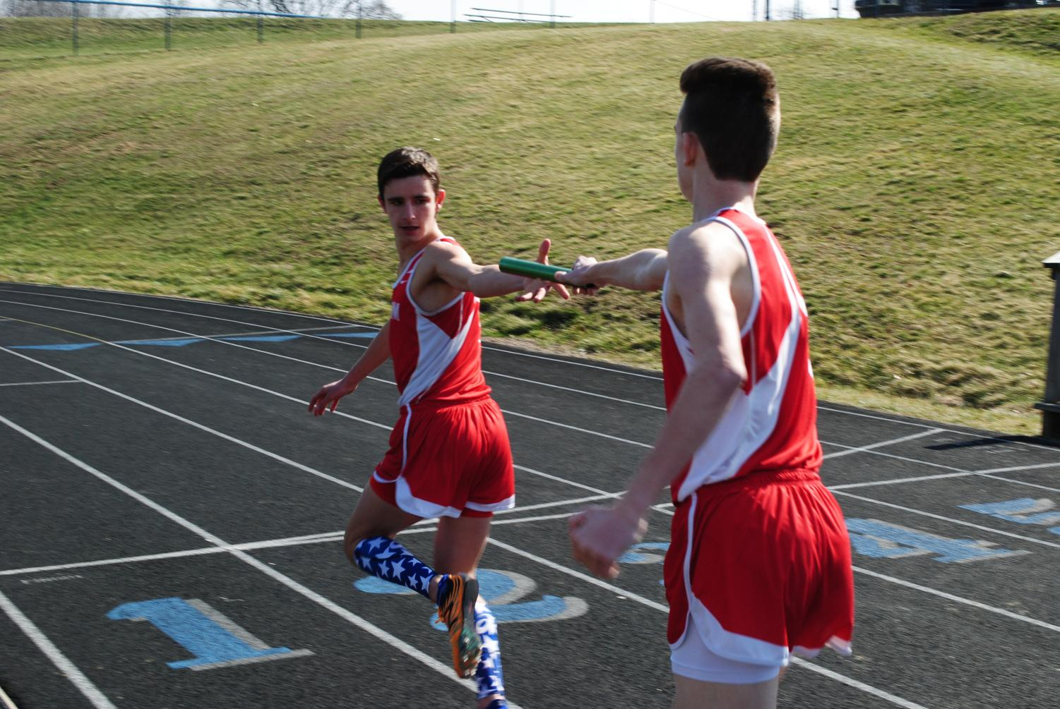 Then sophomore Ethan Paxton hands the baton to then senior Jarrett Boyd during a meet at Central Valley back in 2017.