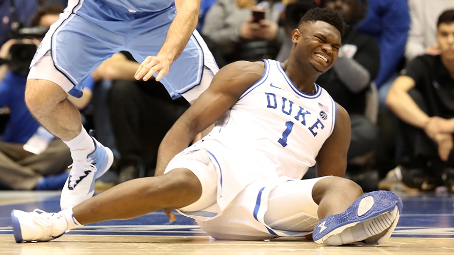 Duke+freshman+Zion+Williamson+grimaces+in+pain+as+he+lies+on+the+court%2C+moments%0Aafter+his+shoe+split+against+North+Carolina+on+Feb.+20.